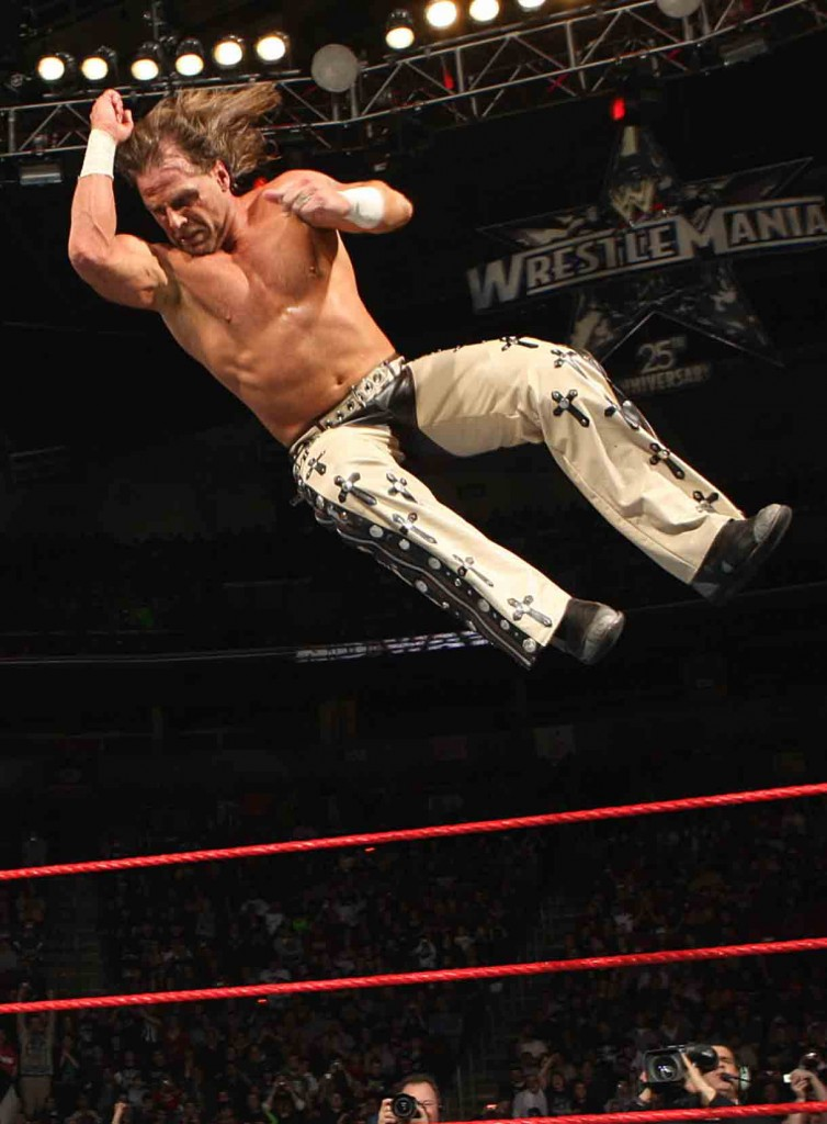 Shawn Michaels prepares to land with devastation during a WWE match. (Copyright Photo: WWE)