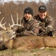 Shawn Michaels, left, with his MacMillan River Adventures co-host Keith Mark and a buck Michaels killed while filming a hunt.