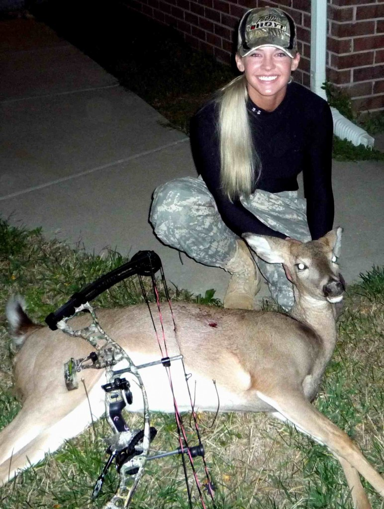 Theresa Vail, in an older photo, with a doe. She loves hunting deer and squirrels.