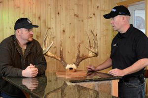 Deer & Deer Hunting Editor Dan Schmidt (right) talks with Jay Fish.