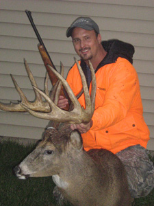 Johnny King with a mount of his buck
