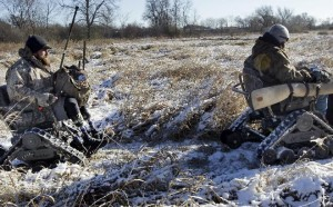 Jake Janes (left) and Chad Hermanson head back to their trucks after duck hunting. The pair, who have been friends and hunting buddies for years, are still able to pursue their passion with all-terrain wheelchairs. (Photo: Mark Hoffman/Milwaukee Journal Sentinel)