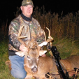 The author with his 9-point buck felled by a NAP Spitfire broadhead and Wicked Ridge crossbow in a Banks Blind stand that produced two more fine bucks within 24 hours.