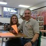 Father and daughter in the same class? Tom Schneider gets ready to sail a paper airplane.
