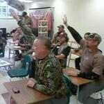 These camo-clad students can barely fit into their desks!