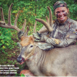 Brooke Merrill with her buck that almost caused her to miss her bridal shower!