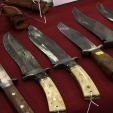 You may find an old, or new, hunting knife at BLADE Show or possibly someone to create the knife you want.