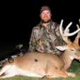 Brian Woodard Jr. with his buck-doe, which likely is a hermaphrodite with both ovaries and testes.