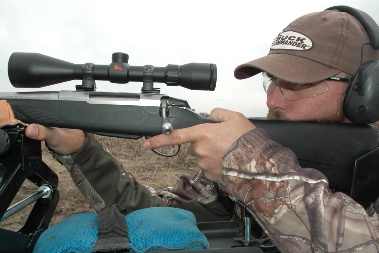 Tom Martin with Buck Commander zeroes in a Weaver Buck Commander scope.