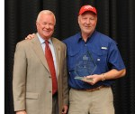 Mark Whitlock, right, accepts an award from the Alabama Retail Association in 2010. (Photo: ARA)