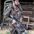 Crossbow hunter with climbing stand