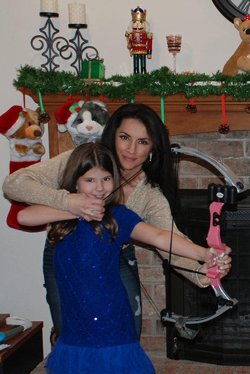 Nicole McClain gives her niece her very first compound bow as a birthday gift