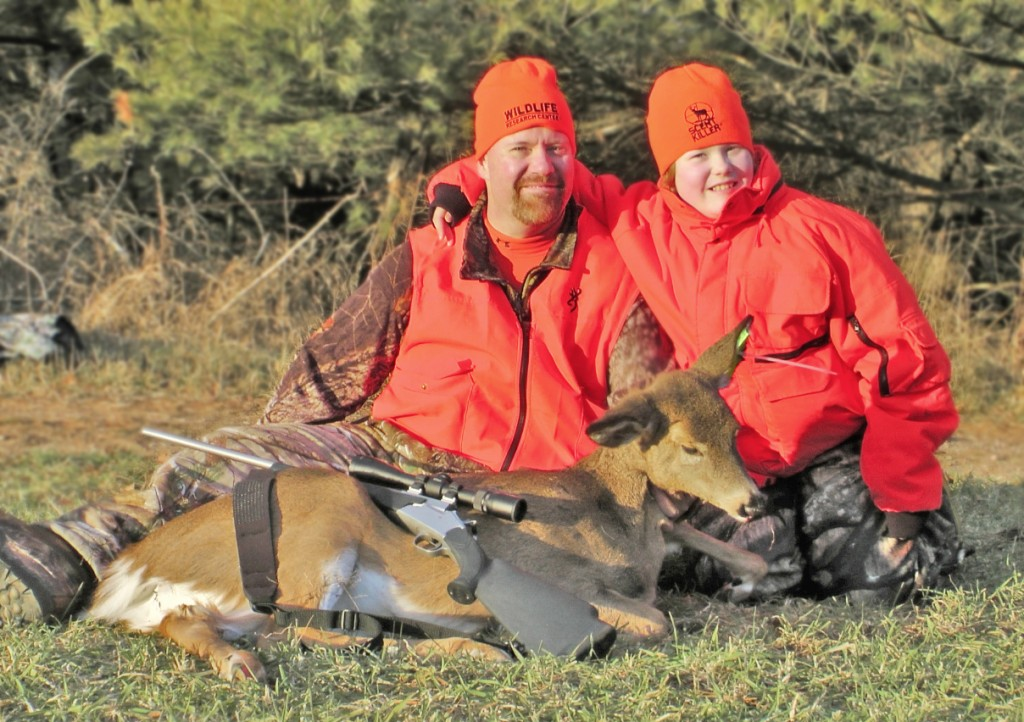 Taylor Schmidt, 11, is all smiles after bagging her first deer while hunting with her dad during Wisconsin's gun-deer season. (photo courtesy of Cory Johnson)