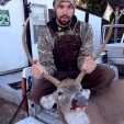 Dennie Bowman of North Carolina with his giant spike buck killed in late 2013.