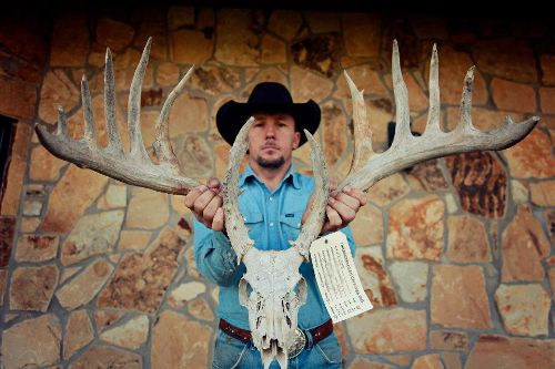 J.W. Hart with the near-200 B&C whitetail shed found in Oklahoma.