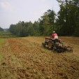 Food plots tractor plowing