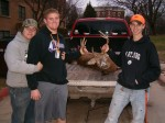 My buddies Willy and Justin on the left with me and my buck. In the background is our campus where I go to school, Wartburg College.