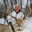 The author with a gorgeous buck dropped with his Traditions muzzleloader, which he treats carefully during and after the season to achieve optimal performance.
