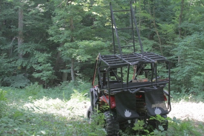 Tree stand loaded and waiting. We had to clear some small bushes and trees before getting it up.