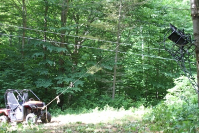 Check out the rope attached to the Honda Pioneer holding the tree stand up while we adjust it's location.