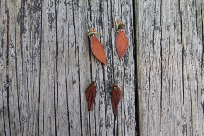Earrings made from deer hide and gem stones.
