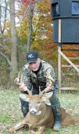 Jack Weber, the camp sage and oldest hunter, with his great buck shot from the Banks Blind behind him with a TenPoint crossbow.