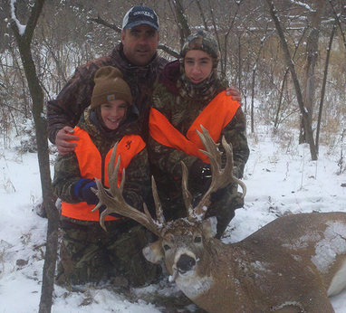 Jason Krebs and sons with an awesome Nebraska whitetail Wow!