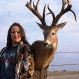 Linet Navarro of Oklahoma with her monster non-typical buck that scored 175 net.