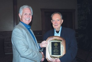 Gail Martin, right, during his induction into the Archery Hall of Fame.