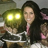Deer hunter Nicole Mcclain wears the Huntworth camo hoodie with her Rottweiler Mog