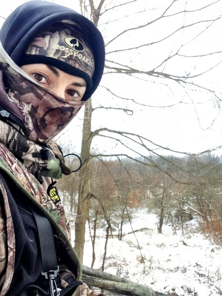 Deer hunter Nicole McClain sits in treestand in the snow