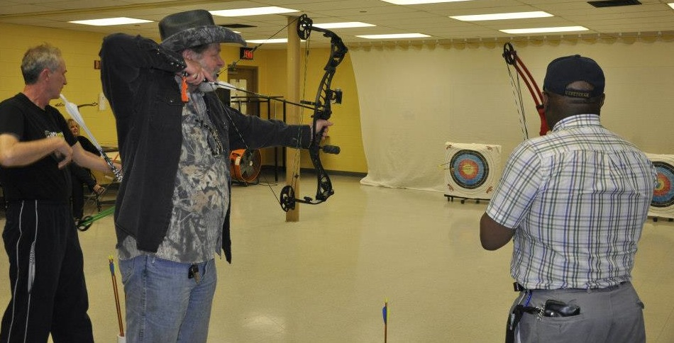 Ted Nugent shoots a few arrows with the men at Exodus Place in Grand Rapids, Mich., during a recent visit. (Photo: Exodus Place)
