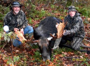 Rick Giguere, left, and Dave Redfield with Giguere's 48.75-inch bull from the 2010 season.