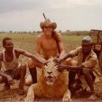Ted with his sustainable renewable ethically killed lion while on safari.