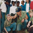 Nugent opens his private ranch to inner city kids for a day of tree-planting, fishing and discovery.