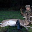Tanner Hornback with his big buck, his first one ever.