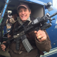 Ted in a helicopter with a machine gun
