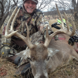 Yowza! Ted Nugent with a nice buck!