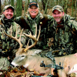 Three lifelong buck hunters and best friends (from left), Tom Miranda, Stan Potts and Joel Snow pose in an Ohio woodlot with Miranda's Union County buck.