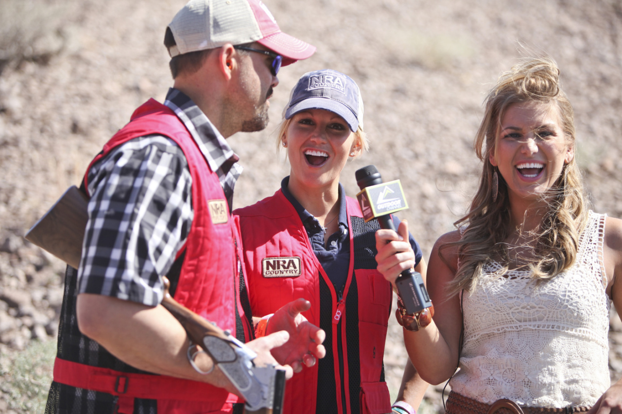 Lee and Tiffany Lakowsky enjoy an interview at the NRA Country/ACM sporting clays shoot in Las Vegas. (Photo: Sara Kauss)