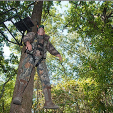 Treestand Safety hunter hanging from tree