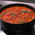 This pot of hot chili has beans and tomato sauce, both a point of contention in the chili world. What's your take on ingredients to use in venison chili?