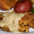 Venison chicken fried on plate
