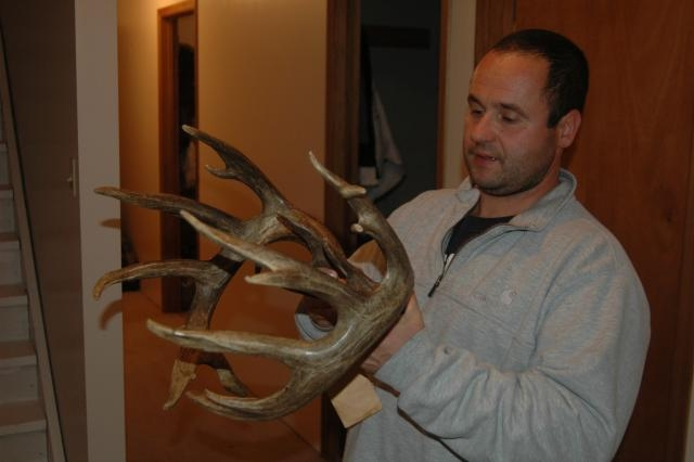 A hunter from New Jersey admires a 195-inch buck taken at Garden River Outfitters.