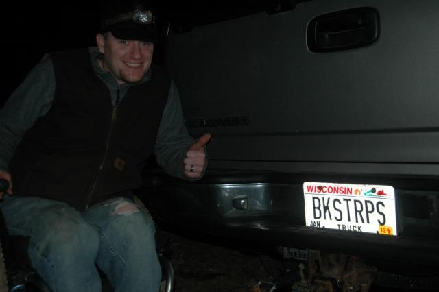Jason Dorshorst shows his Ted Nugent-inspired license plate to Deer & Deer Hunting Editor Dan Schmidt.