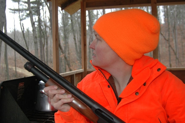 Tracy Schmidt scans the woods for deer.